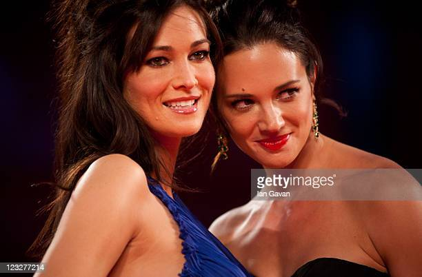 Actresses Manuela Arcuri and Asia Argento attend the Carnage premiere at the Palazzo Del Cinema during the 68th Venice Film Festival on September 1...