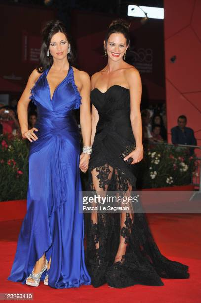 Actresses Manuela Arcuri and Asia Argento attends the Carnage premiere at the Palazzo Del Cinema during the 68th Venice Film Festival on September 1...