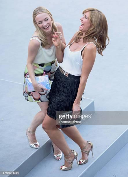 Actresses Mareille Hoeppner and Janin Ullmann attend the Marc Cain show during the MercedesBenz Fashion Week Berlin Spring/Summer 2016 at Brandenburg...