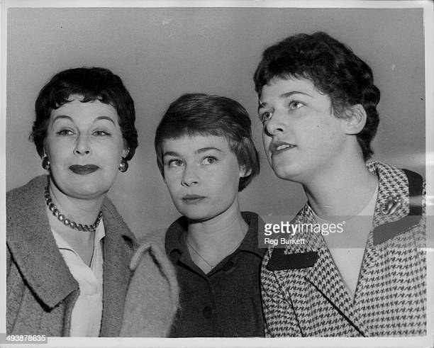 Actresses Margaret Courtenay Judi Dench and Jennie Goossens with the Old Vic Theatre Company posing at London Airport on their way to Belgrade London...