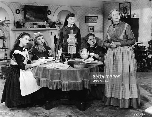 Actresses Margaret O'Brien Elizabeth Taylor June Allyson Janet Leigh and Lucile Watson in character as the March women drinking tea on the set of a...