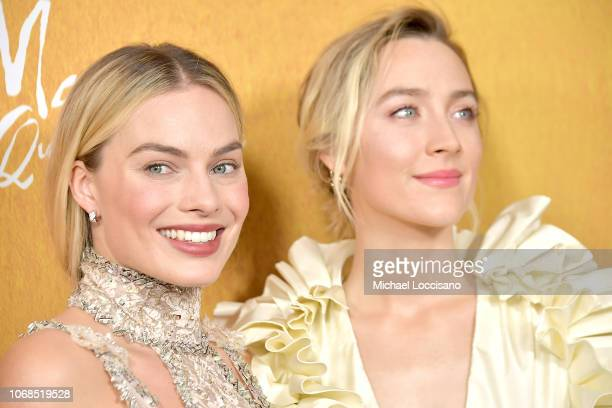 Actresses Margot Robbie and Saoirse Ronan attend the New York premiere of Mary Queen Of Scots at Paris Theater on December 4 2018 in New York City