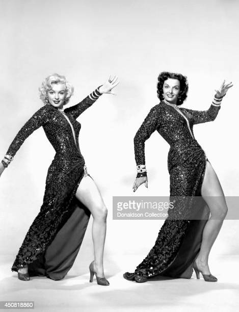 Actresses Marilyn Monroe and Jane Russell pose for a publicity portrait for the film 'Gentlemen Prefer Blondes' in 1953 in Los Angeles California
