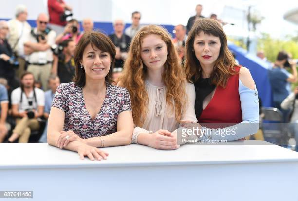 Actresses Marilyne Canto Charlotte Cetaire and director Annarita Zambrano attend the Dopo La Guerra Apres La Guerre photocall during the 70th annual...