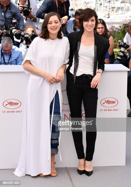 Actresses Marion Cotillard and Charlotte Gainsbourg attends the 'Ismael's Ghosts ' photocall during the 70th annual Cannes Film Festival at Palais...