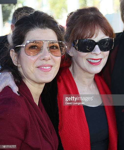 Actresses Marisa Tomei and Frances Fisher attend the kickoff for One Billion Rising in West Hollywood on February 14 2013 in West Hollywood California