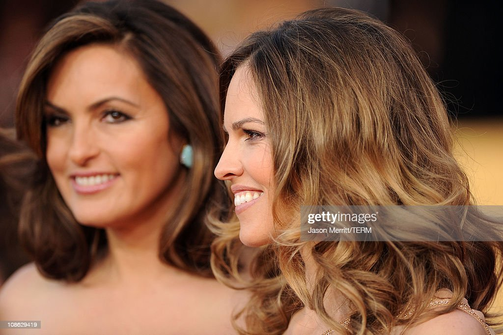 Actresses Mariska Hargitay and Hilary Swank arrive at the 17th Annual Screen Actors Guild Awards held at The Shrine Auditorium on January 30, 2011 in Los Angeles, California.