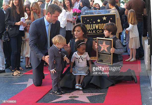 Actresses Mariska Hargitay poses with her husband Peter Hermann and her children as she attends a ceremony where Hargitay was honored with a star on...