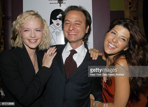 Actresses Marley Shelton and Marisa Tomei play a charming scene for their smiling director Fisher Stevens at a party at Man Ray on W 15th St...