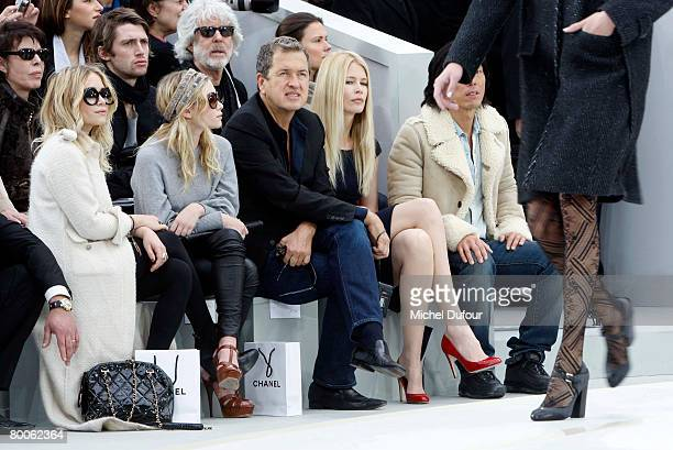 Actresses Mary Kate Olsen Ashley Olsen photographer Mario Testino and model Claudia Schiffer attend the Chanel Fashion show during Paris Fashion Week...