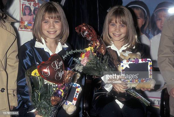Actresses MaryKate and Ashley Olsen autograph copies of the their new children's mystery book series 'The Adventure of MaryKate Ashley Olsen' on...