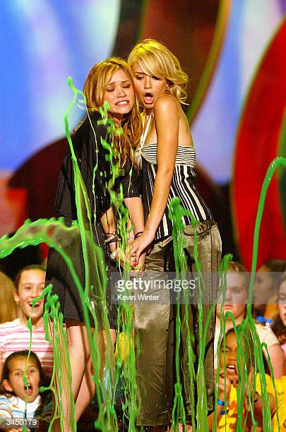 Actresses MaryKate and Ashley Olsen get slimed on stage during Nickelodeon's 17th Annual Kids' Choice Awards at Pauley Pavilion on the campus of UCLA...