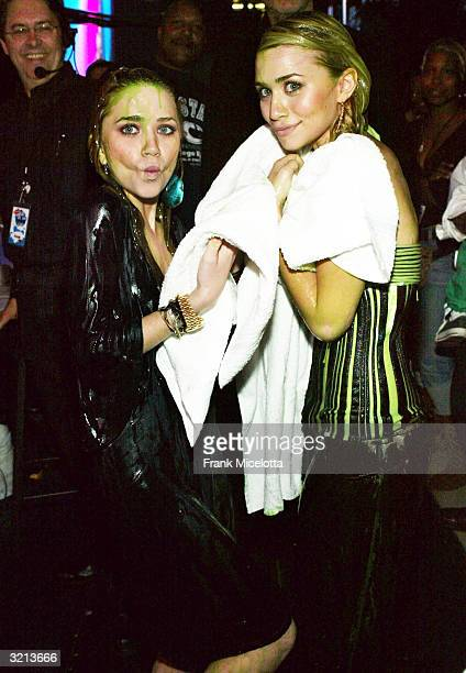 Actresses MaryKate and Ashley Olsen pose after getting slimed during Nickelodeon's 17th Annual Kids' Choice Awards at Pauley Pavilion on the campus...