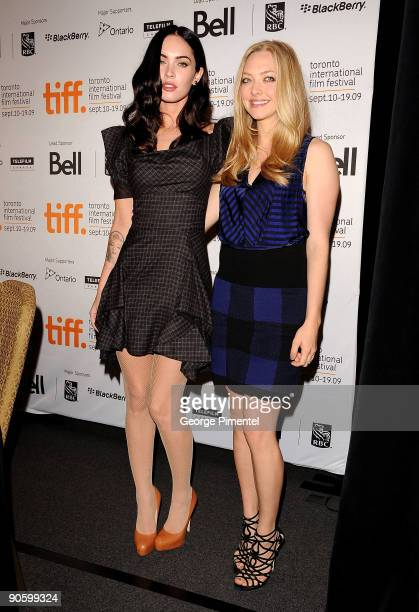 Actresses Megan Fox and Amanda Seyfried pose onstage at the 'Jennifer�s Body' press conference held at the Sutton Place Hotel on September 11 2009 in...