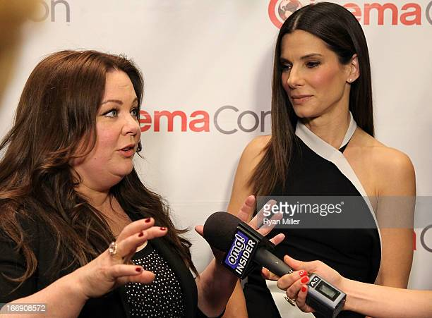 Actresses Melissa McCarthy and Sandra Bullock arrive at the 20th Century Fox Cinemacon Press Conference at Caesars Palace during CinemaCon the...