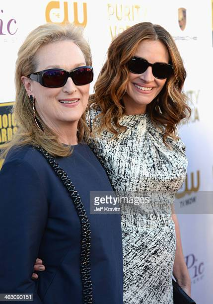 Actresses Meryl Streep and Julia Roberts attend the 19th Annual Critics' Choice Movie Awards at Barker Hangar on January 16 2014 in Santa Monica...