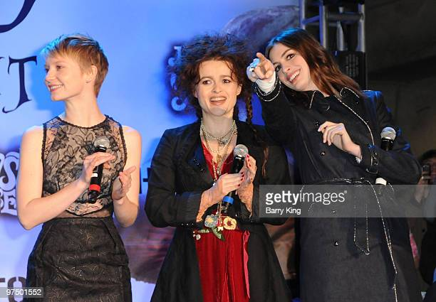 Actresses Mia Wasikowska Helena Bonham Carter and Anne Hathaway attend the 'Alice In Wonderland' Great Big Ultimate Fan Event at Hollywood Highland...