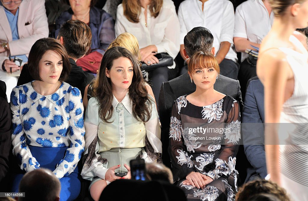 Actresses Michelle Dockery (L) and Christina Ricci (R) attend the Carolina Herrera fashion show during Mercedes-Benz Fashion Week Spring 2014 at The Theatre at Lincoln Center on September 9, 2013 in New York City.