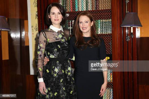 Actresses Michelle Dockery and Julianne Moore attend a photocall for 'Non Stop' at The Dorchester on January 30 2014 in London England