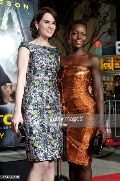 """Actresses Michelle Dockery and Lupita Nyong'o attend the premiere of Universal Pictures and Studiocanal's """"Non-Stop"""" at Regency Village Theatre on..."""