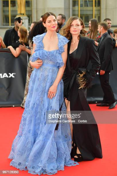 Actresses Michelle Monaghan and Rebecca Ferguson attend the 'Mission Impossible Fallout' Global Premiere in Paris on July 12 2018 in Paris France