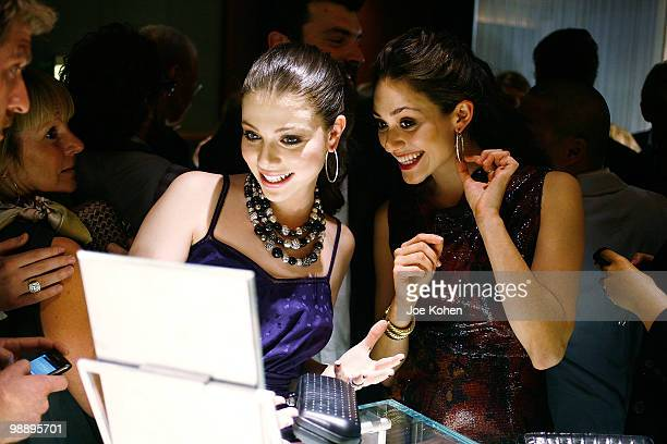 Actresses Michelle Trachtenberg and Emmy Rossum attend the 30th Anniversary celebration cocktail reception with Rebirth of NYC Flagship hosted by...