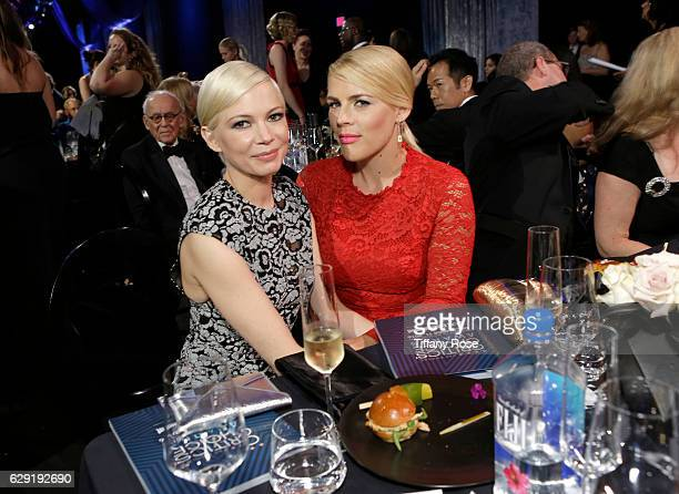 Actresses Michelle Williams and Busy Philipps attend the 22nd Annual Critic's Choice Awards at Barker Hangar on December 11 2016 in Santa Monica...