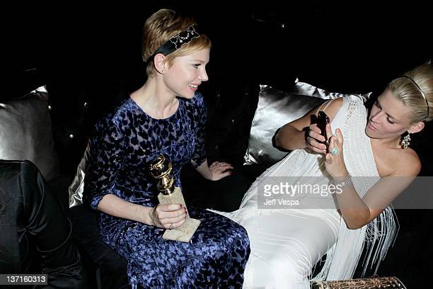 Actresses Michelle Williams and Busy Philipps attend The Weinstein Company's 2012 Golden Globe Awards After Party with Chopard Marie Claire and HP at...