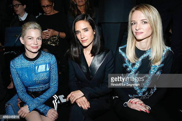 Actresses Michelle Williams Jennifer Connelly and Louis Vuitton's executive vice president Delphine Arnault attend the Louis Vuitton show as part of...