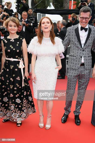 Actresses Millicent Simmonds Julianne Moore and Screenwriter Brian Selznick leave the Wonderstruck screening during the 70th annual Cannes Film...