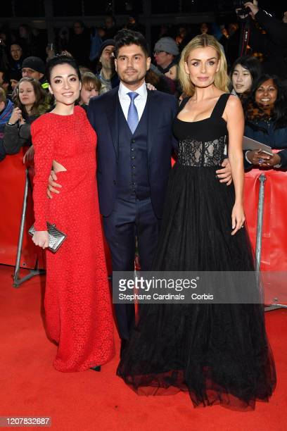 Actresses Minami Katherine Jenkins and director Andrew Levitas poses at the Minamata premiere during the 70th Berlinale International Film Festival...