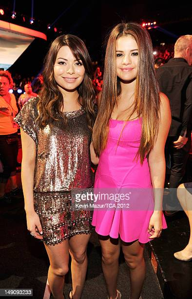Actresses Miranda Cosgrove and Selena Gomez attend the 2012 Teen Choice Awards at Gibson Amphitheatre on July 22 2012 in Universal City California