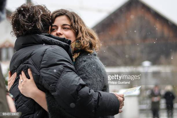 Actresses Monika Baumgartner and Ronja Forcher embrace during the memorial service for Siegfried Rauch at St Ulrich Church on March 19 2018 in Habach...