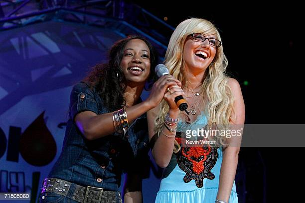 Actresses Monique Coleman and Ashley Tisdale introduce Jesse McCartney onstage during the Radio Disney Totally 10 Birthday Concert held at the...