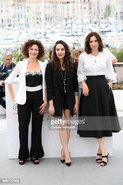 Actresses Nadia Kaci Hania Amar and Aure Atika attend 'Waiting For Swallows ' photocall during the 70th annual Cannes Film Festival at Palais des...