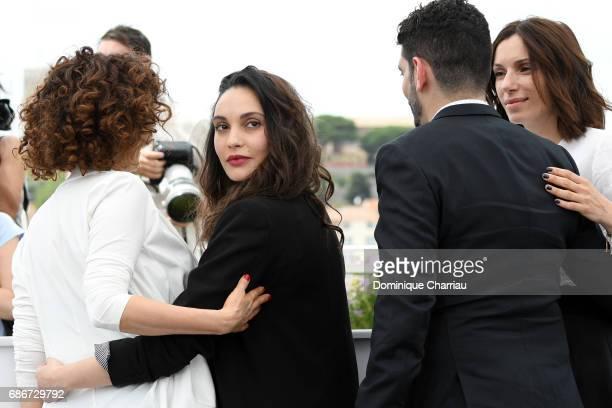 Actresses Nadia Kaci Hania Amar director Karim Moussaoui and actress Aure Atika attend 'Waiting For Swallows ' photocall during the 70th annual...
