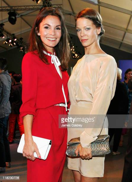 Actresses Nadine Warmuth and Jessica Schwarz attend the Opening Night by GRAZIA MercedesBenz Fashion Week Berlin Spring/Summer 2012 at the...