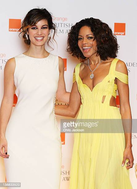 Actresses Naomie Harris and Berenice Marlohe poses in the press room during the Orange British Academy Film Awards 2012 at the Royal Opera House on...
