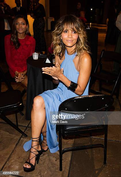 Actresses Naomie Harris and Halle Berryt attend 'Spectre' The Black Women of Bond Tribute at California African American Museum on November 3 2015 in...
