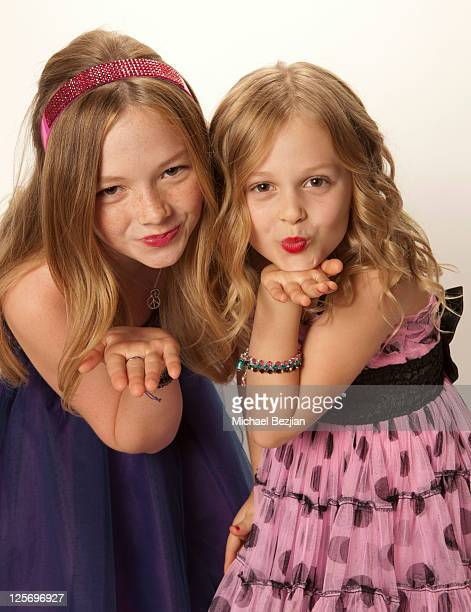 Actresses Natalie Alyn Lind and Emily Alyn Lind pose at a photo shoot on September 20 2011 in Los Angeles California