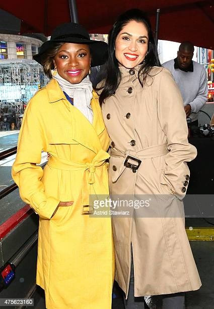 Actresses Naturi Naughton and Lela Loren from the cast of 'Power' hand out tickets to the New York premiere of 'Power' TV series on June 2 2015 in...
