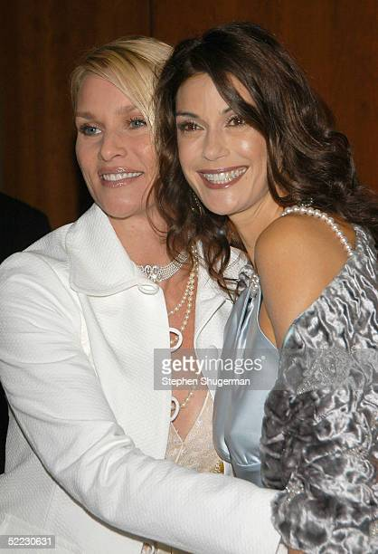 Actresses Nicollette Sheridan and Teri Hatcher pose at An Evening With Desperate Housewives at The Academy of Television Arts Sciences on February 22...