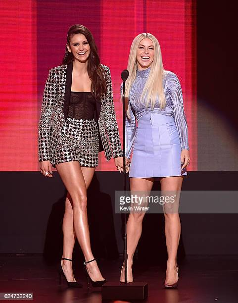 Actresses Nina Dobrev and Julianne Hough speak onstage during the 2016 American Music Awards at Microsoft Theater on November 20 2016 in Los Angeles...
