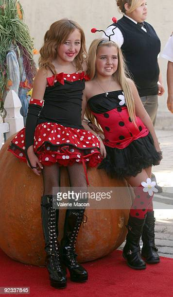Actresses Noah Cyrus and Emily Grace Reaves arrives at camp Ronald McDonald for good times 17th annual Halloween Carnival at Universal Studios...