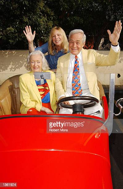 Actresses Noel Neill Candy Clark actor Jack Larson pose for a photograph inside a classic hot rod at the 13th Annual Stater Bros Route 66 Rendezvous...