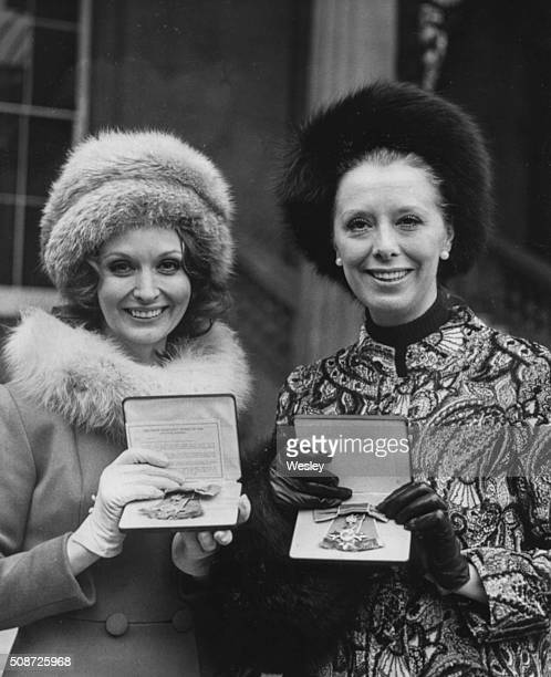Actresses Nyree Dawn Porter and Margaret Tyzack pictured holding their OBE awards after receiving their investitures at Buckingham Palace London...