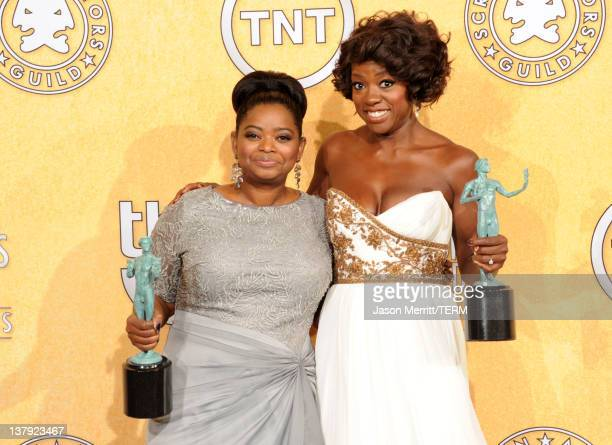 Actresses Octavia Spencer and Viola Davis pose in the press room with her award for Outstanding Performance By A Cast In A Motion Picture for 'The...