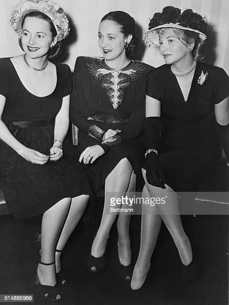 Actresses Olivia de Havilland Dorothy Lamour and Joan Fontaine attend a farewell party in their honor at the Stork Club before heading off to the...