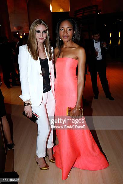 Actresses Olivia Palermo and Naomie Harris enjoy a Martell cocktail at the Martell 300th anniversary event held at the Palace of Versailles on May 20...