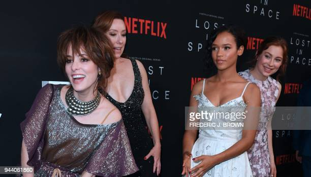 Actresses Parker Posey Molly Parker Taylor Russell and Mina Sunwall arrive for Netflix's Lost In Space Season 1 Premiere event in Los Angeles on...
